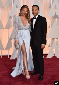 Chrissy Teigen, left, and John Legend