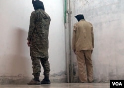 Islamic State fighters imprisoned by Kurdish YPG authorities in the northeastern town of Al-Malikiyah, Syria, March 23, 2015. (Zana Omer/VOA)