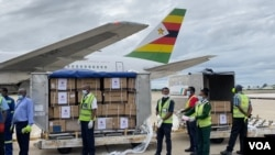 Health officials load 200,000 Sinopharm COVID-19 vaccine doses, donated by China, into a government truck at the Robert Gabriel Mugabe International Airport in Harare, Feb. 15, 2021. (Columbus Mavhunga/VOA)