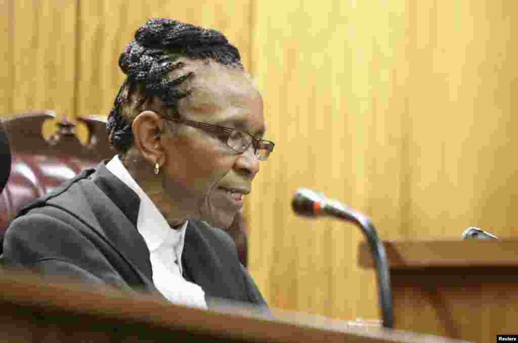Judge Thokozile Masipa delivers judgment during the appeal by prosecutors against the verdict and sentence of Oscar Pistorius in the North Gauteng High Court in Pretoria, Dec. 10, 2014.
