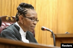 FILE - Judge Thokozile Masipa delivers judgment during the appeal by prosecutors against the verdict and sentence of Oscar Pistorius in the North Gauteng High Court in Pretoria, Dec. 10, 2014.