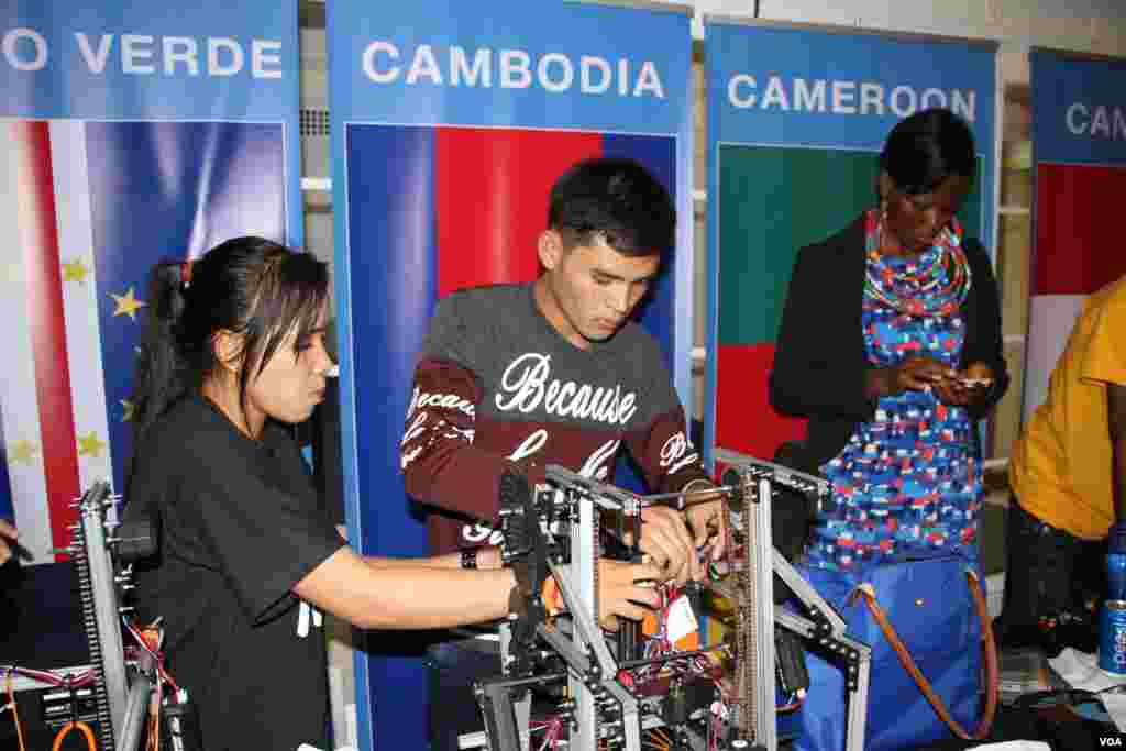 Cambodian youth robotics team examine their robot before joining their first competition at the First Global Challenge in Washington, DC, Monday, July 17, 2017. (Sophat Soeung/VOA Khmer)
