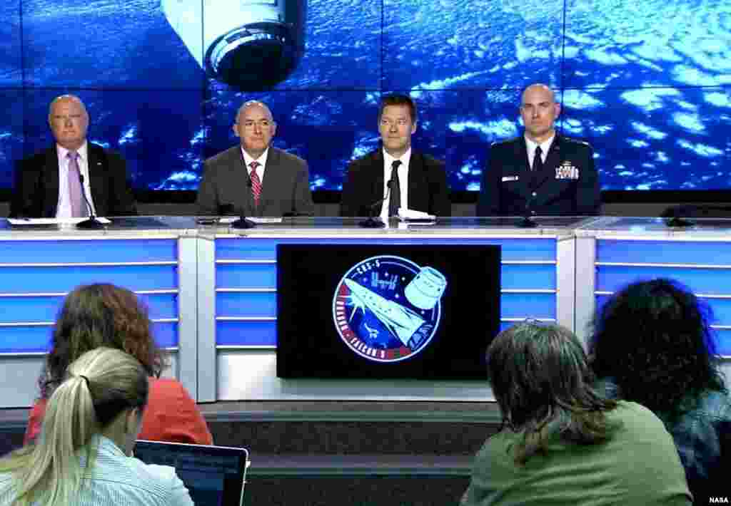 In the Kennedy Space Center's Press Site auditorium, agency and industry leaders speak to members of the news media on International Space Station research and technology developments, Jan 5, 2015.