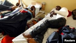 Wounded Congolese army fighters rest inside a ward as they receive treatment at the HEAL Africa teaching hospital in Goma, in the eastern Democratic Republic of Congo, Aug. 27, 2013.