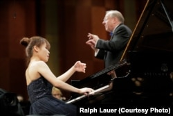 Rachel Cheung of Hong Kong performs with conductor Nicholas McGegan and the Fort Worth Symphony Orchestra on Sunday in the Semifinal Round at the 15th Van Cliburn International Piano Competition.