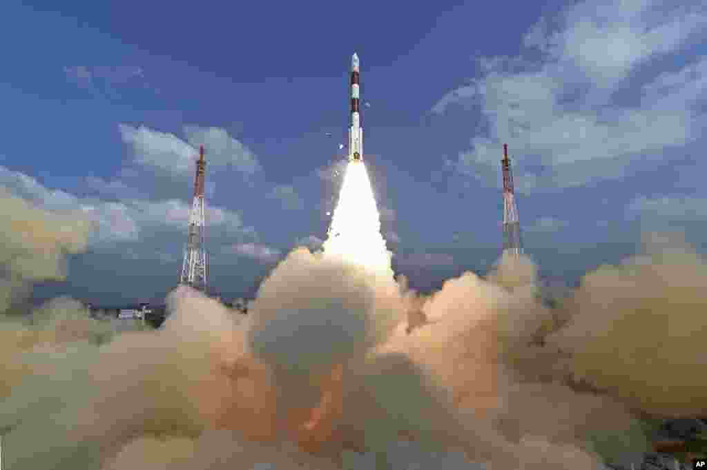 This photograph released by Indian Space Research Organization shows its polar satellite launch vehicle lifting off from a launch pad at the Satish Dhawan Space Centre in Sriharikota.