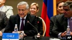 智利外長埃拉爾多穆尼奧斯3月14日與拉丁美洲代表們會議資料圖。