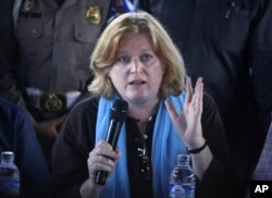 "FILE - Anne Richard, assistant secretary of state for population, refugees and migration, says the resettlement mechanism was set up ""to help cover the cost of screening refugees, and the transportation to get the refugees to these new resettlement countries."""