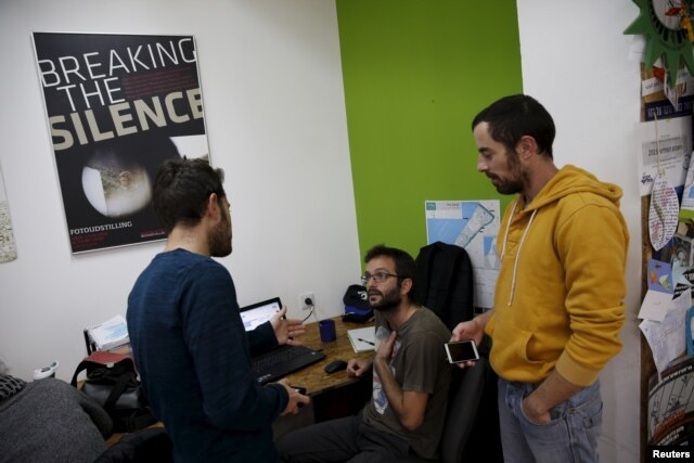 """Employees work at the offices of """"Breaking the Silence"""" in Tel Aviv, Israel, December 16, 2015. An ultra-nationalist Israeli group has published a video accusing the heads of four Israel's leading human rights organisations, including """"Breaking the Silenc"""