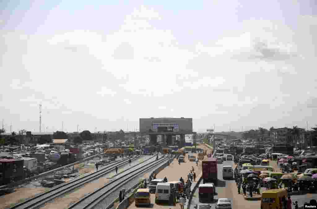 A general view of the traffic beside a light rail project under construction along Mile 2 in Lagos.