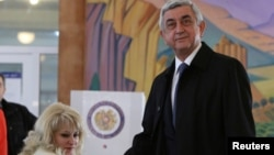 Armenia's President Serzh Sarksyan casts his ballot during a parliamentary election at a poling station in Yerevan, Armenia, April 2, 2017.