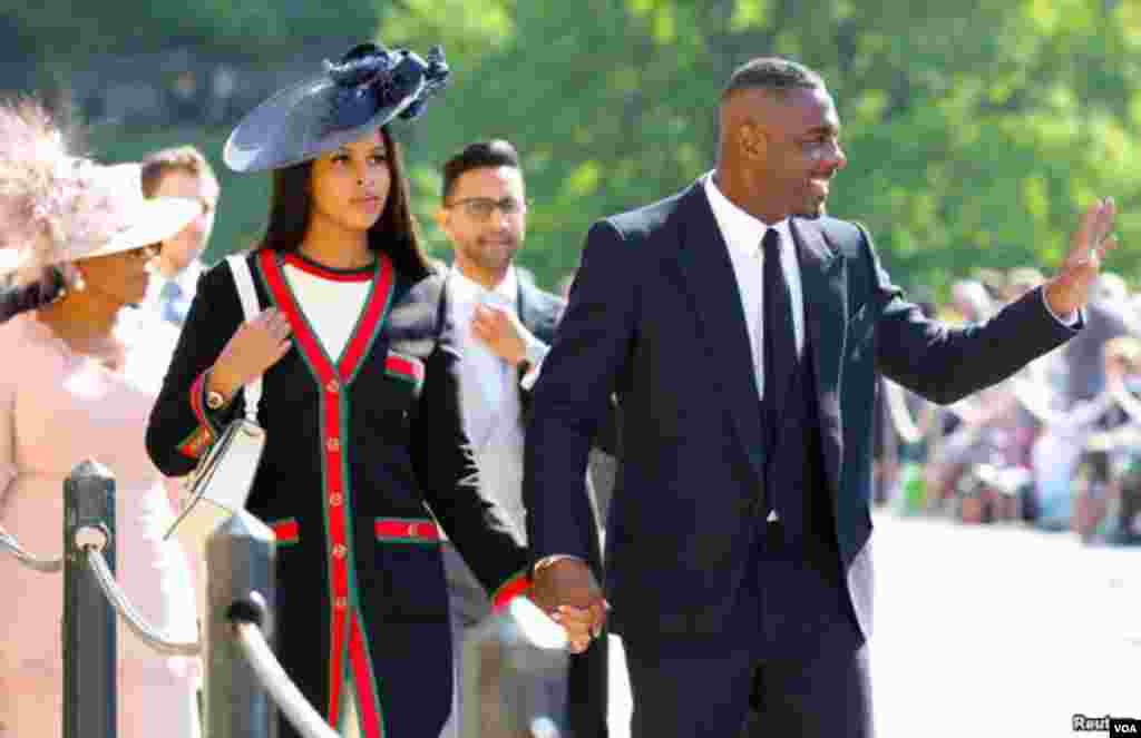 Idris Elba na Sabrina Dhowre wakiwasili katika Kanisa la Mtakatifu George's, katika Kasri ya Windsor kuhudhuria ndoa ya Meghan Markle and Prince Harry Mei 19, 2018.