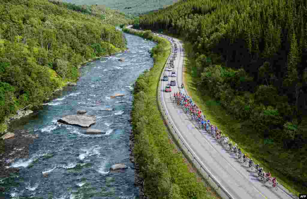 Cyclists ride during the 184.5-kilometer second stage of the Arctic Race of Norway between Sjoevegan and Bardufoss Airport in Norway.