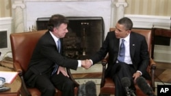 President Barack Obama shakes hands with Colombian President Juan Manuel Santos, Thursday, April 7, 2011, in the White House