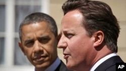 Britain's Prime Minister David Cameron (R) speaks during a joint news conference with U.S. President Barack Obama at Lancaster House, in central London, May 25, 2011