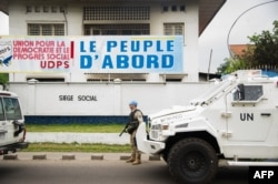 FILE - A peacekeeper of the MONUSCO, the U.N. mission in the Democratic Republic of Congo, stands guard in front of the offices of the main opposition Union for Democracy and Social Progress (UDPS) party, in Kinshasa, Sept. 20, 2016