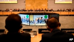 """Participants attend the """"No Money for Terror"""" conference at the Organization for Economic Cooperation and Development in Paris, April 26, 2018. Ministers from more than 70 countries worked on ways to combat financing for the Islamic State group and al-Qaida."""