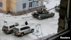 The Organization for Security and Cooperation in Europe (OSCE) cars and tanks are seen in the government-held industrial town of Avdiyivka, Ukraine, Feb. 1, 2017.