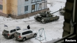 The Organization for Security and Cooperation in Europe (OSCE) cars and tanks are seen in the government-held industrial town of Avdiivka, Ukraine, Feb. 1, 2017.