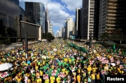 Demonstrators attend a protest against Brazil's President Dilma Rousseff, part of nationwide protests calling for her impeachment, at Paulista Avenue in Sao Paulo's financial centre, Brazil, Aug. 16, 2015.