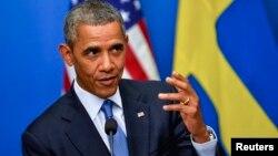 El presidente Barack Obama habla durante la conferencia de prensa conjunta con el primer ministro sueco, Fredrik Reinfeldt.