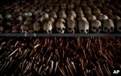 FILE - Skulls and bones of some of those killed in Rwanda's genocide are seen at a memorial shrine at a Catholic church in Ntarama, Rwanda, April 4, 2014.