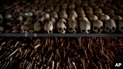 FILE - Skulls and bones of some of those killed in Rwanda's genocide are seen at a memorial shrine in Ntarama, Rwanda, April 4, 2014. A designation of genocide does not require any particular action by the U.S.