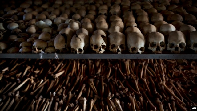 FILE - Skulls and bones of Rwandan genocide victims line a memorial shrine at a Catholic church in Ntarama, Rwanda, April 4, 2014. Congo's justice minister said his country would extradite Ladislas Ntaganzwa, charged with participating in the killings.