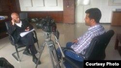 Almigdad Mojalli conducts an interview, Jan., 2015.