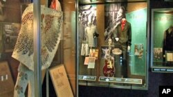 The exhibit at the Newseum features clothing worn by Elvis, which is on loan from Graceland.
