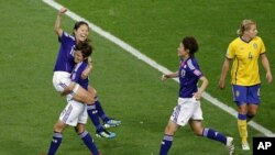 Homare Sawa (L) of Japan celebrates with her teammate Nahomi Kawasumi after scoring against Sweden during their Women's World Cup semi-final soccer match in Frankfurt, July 13, 2011