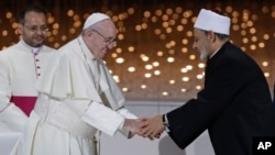 Pope Francis greets Sheikh Ahmed el-Tayeb, the grand imam of Egypt's Al-Azhar, after an Interreligious meeting at the Founder's Memorial in Abu Dhabi, United Arab Emirates, Feb. 4, 2019.