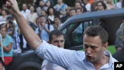 FILE - In this file photo taken on Friday, Aug. 17, 2012, Russian protest leader Alexei Navalny gestures as he walks outside a court in Moscow, Russia.