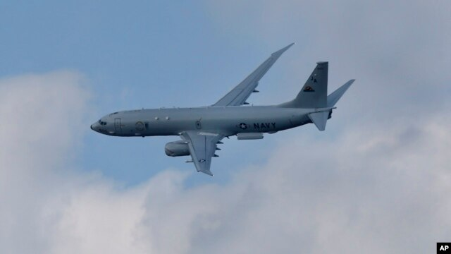 FILE - A Boeing P-8-A Poseidon flies on display during Farnborough International Air Show, Farnborough, England.