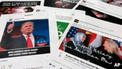 FILE - Some of the Facebook and Instagram ads linked to a Russian effort to disrupt the American political process and stir up tensions around divisive social issues, released by members of the U.S. House Intelligence committee, are photographed in Washington.