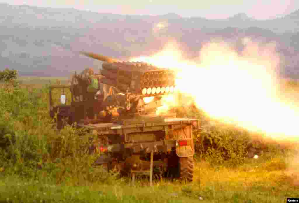 Rockets are fired from a Congolese army vehicle in the direction of M23 rebels in Kibumba, north of Goma, Oct. 27, 2013.