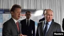 Ruski predsednik Putin i izvršni direktor Gasproma Aleksej Miler. Aug. 3, 2017.