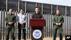 Customs and Border Protection Commissioner Kevin McAleenan (C) announced that the Trump administration will temporarily reassign several hundred border inspectors during a news conference at the border in El Paso, Texas, March 27, 2019.