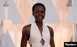 Actress Lupita Nyong'o wears a Calvin Klein gown and Chopard diamonds as she arrives at the 87th Academy Awards in Hollywood, California, Feb. 22, 2015.