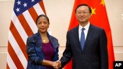 U.S. National Security Adviser Susan Rice, left, and Chinese State Councilor Yang Jiechi, right, shake hands as they pose for a photo at the Diaoyutai State Guesthouse in Beijing, Monday, July 25, 2016.