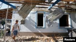 Oštećena kuća u Mariupolju, 7. septembar 2014.