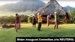 People participate in a Hawaiian chant in a virtual parade on Inauguration Day from Hawaii in this still image from video January 20, 2021.