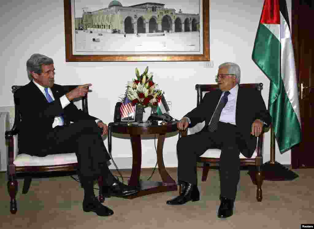 Palestinian President Mahmoud Abbas meets with U.S. Secretary of State John Kerry in the West Bank city of Ramallah, April 7, 2013.