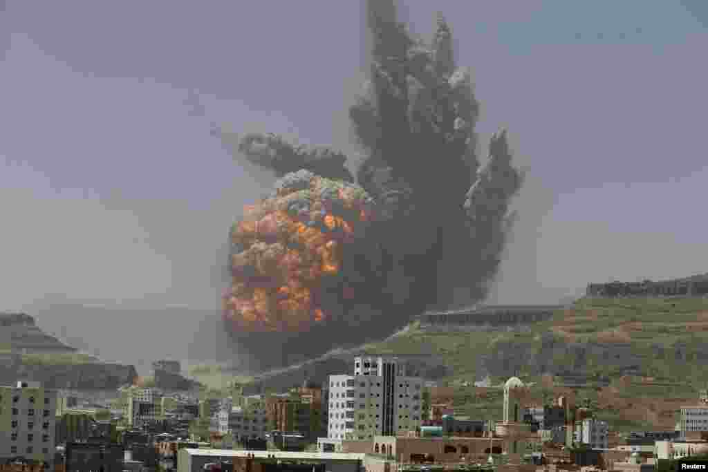 An explosion caused by an airstrike on a weapon depot on a mountain overlooking Yemen's capital Sana'a