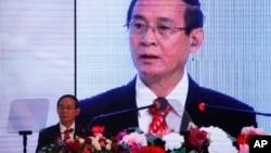 FILE - Myanmar's President Win Myint speaks at a summit in Kathmandu, Nepal, Aug. 30, 2018.