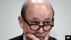 French Defense Minister Jean-Yves Le Drian listens to a speech at the Institute for Strategic Studies (IISS) Shangri-la Security Summit, in Singapore, June 3, 2012.