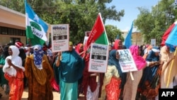 Somali women chant slogans and hold placards as they protest against Somali Islamist group Al-Shabaab at General Kahiye Police Academy in Mogadishu on Jan. 2, 2020.