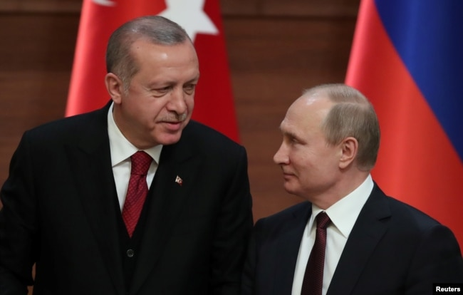 FILE - Presidents Tayyip Erdogan of Turkey and Vladimir Putin of Russia hold a joint news conference after their meeting in Ankara, Turkey, April 4, 2018.