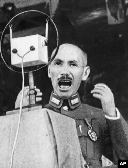 FILE - Gen. Chiang Kai-shek, Chinese strongman, delivers a stirring appeal to his people by radio in an undated photo.