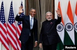FILE - U.S. President Barack Obama and India's Prime Minister Narendra Modi, right, wave during a photo opportunity ahead of their meeting at Hyderabad House, New Delhi, Jan. 25, 2015.